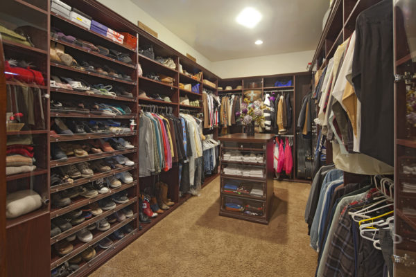 Walk in closet with organised clothing