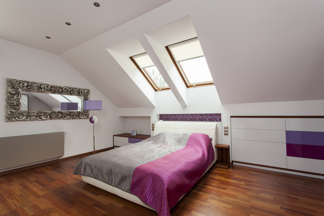 Purple luxurious bedroom in a loft conversion