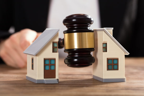 Judge Striking Gavel Between Split House