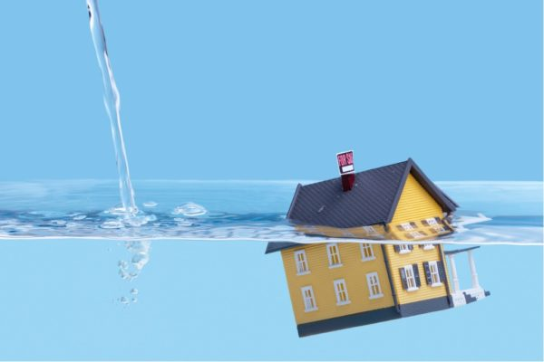 Stock image of house sinking under the water