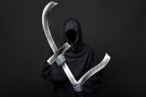 Funeral costs - Halloween image of the death reaper on a black background